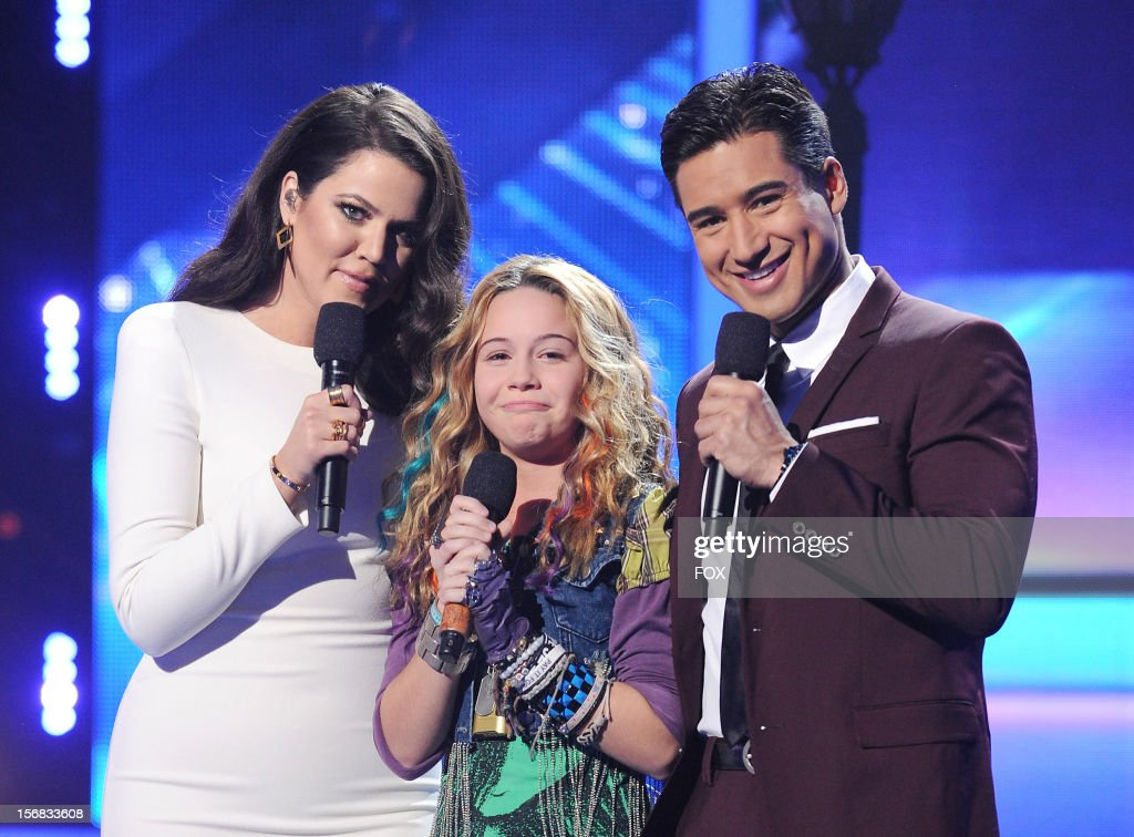 Host Khloe Kardashian Odom, contestant Beatrice Miller and host Mario Lopez onstage at FOX's 'The X Factor' Season 2 Top 10 Live Performance Show on November 21, 2012 in Hollywood, California.