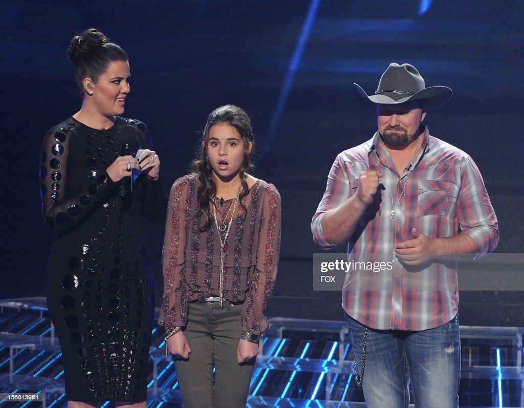 Host Khloe Kardashian Odom, contestant Carly Rose Sonenclar and contestant Tate Stevens onstage at FOX's 'The X Factor' Season 2 Top 10 to 8 Live Elimination Show on November 22, 2012 in Hollywood, California.