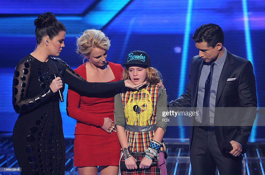 Host Khloe Kardashian Odom, judge Britney Spears, eliminated contestant Beatrice Miller and host Mario Lopez onstage at FOX's 'The X Factor' Season 2 Top 10 to 8 Live Elimination Show on November 22, 2012 in Hollywood, California.