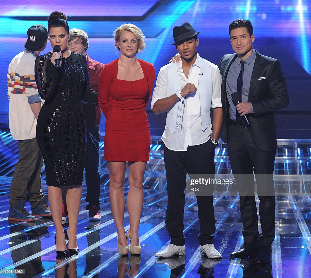 Host Khloe Kardashian Odom, judge Britney Spears, eliminated contestant Arin Ray and host Mario Lopez onstage at FOX's 'The X Factor' Season 2 Top 10 to 8 Live Elimination Show on November 22, 2012 in Hollywood, California.