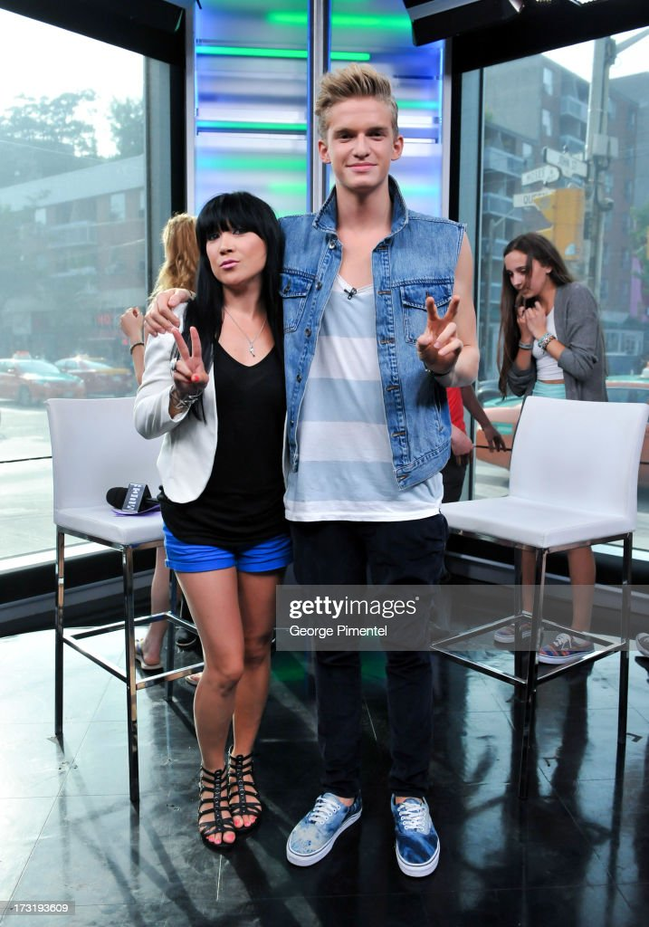 Host Lauren Toyota and co-host <a gi-track='captionPersonalityLinkClicked' href=/galleries/search?phrase=Cody+Simpson&family=editorial&specificpeople=7068455 ng-click='$event.stopPropagation()'>Cody Simpson</a> on NEW.MUSIC.LIVE. at MuchMusic Headquarters on July 9, 2013 in Toronto, Canada.