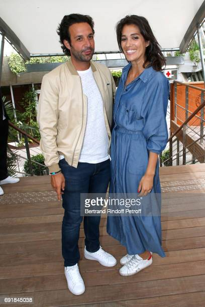 Host Laurie Cholewa and Greg attend the 2017 French Tennis Open Day Seven at Roland Garros on June 3 2017 in Paris France