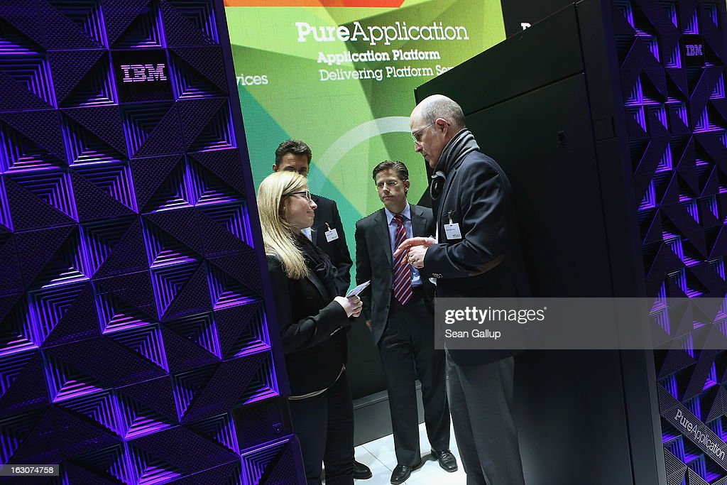 A host leads trade industry professionals among IBM combined server and storage systems at the IBMl stand at the 2013 CeBIT technology trade fair the day before the fair opens to visitors on March 4, 2013 in Hanover, Germany. CeBIT will be open March 5-9.