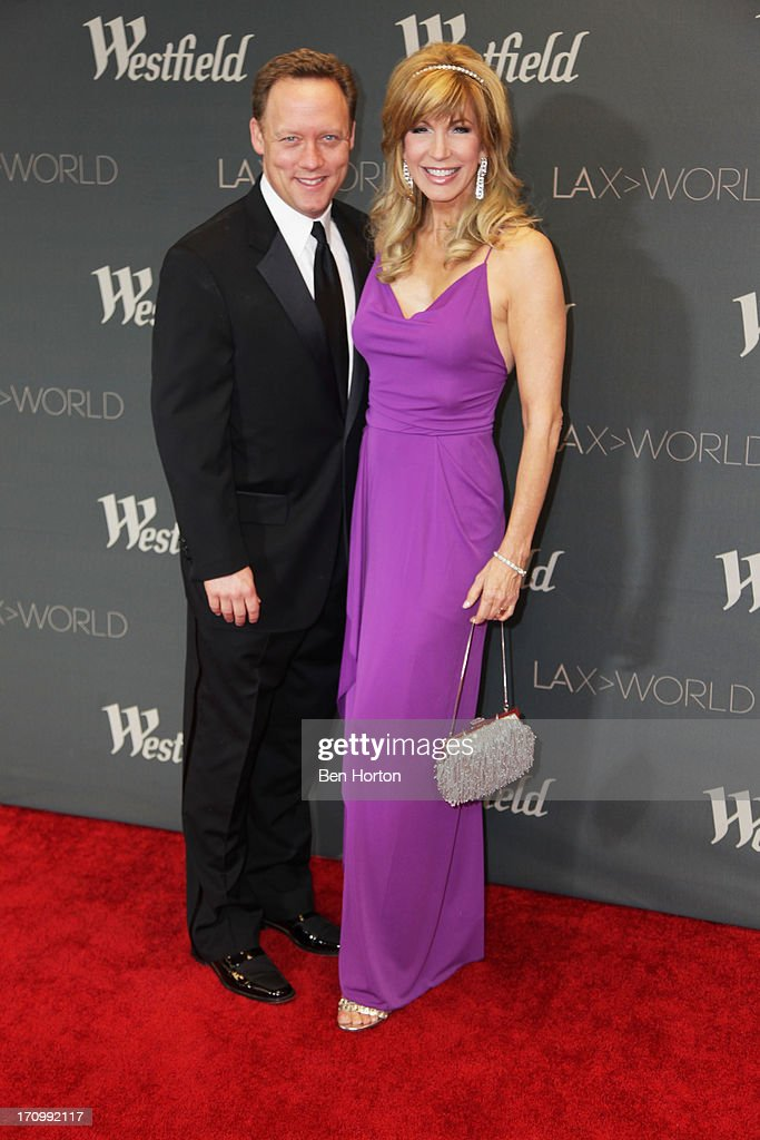TV host <a gi-track='captionPersonalityLinkClicked' href=/galleries/search?phrase=Leeza+Gibbons&family=editorial&specificpeople=217241 ng-click='$event.stopPropagation()'>Leeza Gibbons</a> and her husband attend the Los Angeles World Airports (LAWA) and Westfield present grand opening of the new Tom Bradley International Terminal on June 20, 2013 in Los Angeles, California.