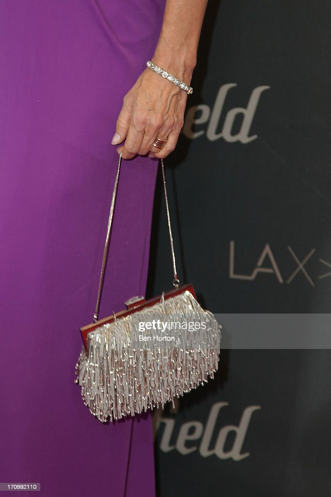 TV host <a gi-track='captionPersonalityLinkClicked' href=/galleries/search?phrase=Leeza+Gibbons&family=editorial&specificpeople=217241 ng-click='$event.stopPropagation()'>Leeza Gibbons</a> (purse detail) attends the Los Angeles World Airports (LAWA) and Westfield present grand opening of the new Tom Bradley International Terminal on June 20, 2013 in Los Angeles, California.