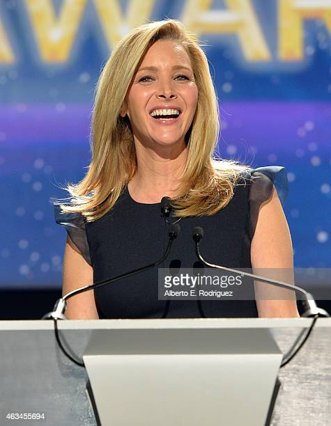 Host Lisa Kudrow speaks onstage at the 2015 Writers Guild Awards LA Ceremony at the Hyatt Regency Century Plaza on February 14 2015 in Century City...