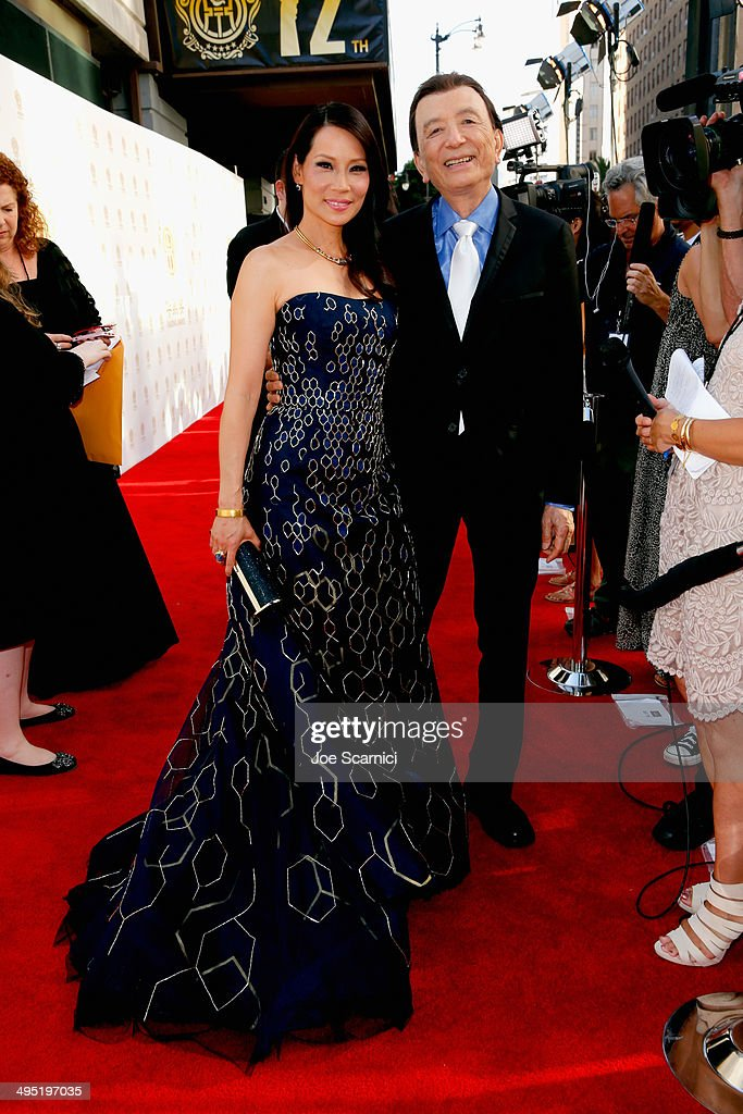 Host Lucy Liu and actor James Hong attend the Huading Film Awards on June 1 2014 at Ricardo Montalban Theatre in Los Angeles California Huading Film...