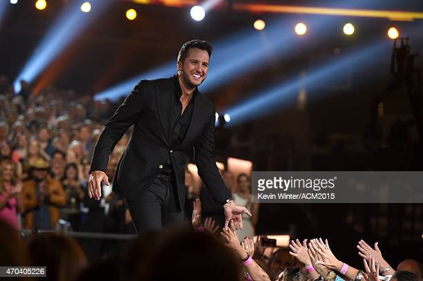 Host Luke Bryan accepts the Entertainer of the Year Award onstage during the 50th Academy of Country Music Awards at ATT Stadium on April 19 2015 in...