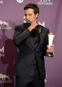 Host Luke Bryan winner of Entertainer of the Year and Vocal Event of the Year for 'The Only Way I Know' poses in the press room during the 48th...