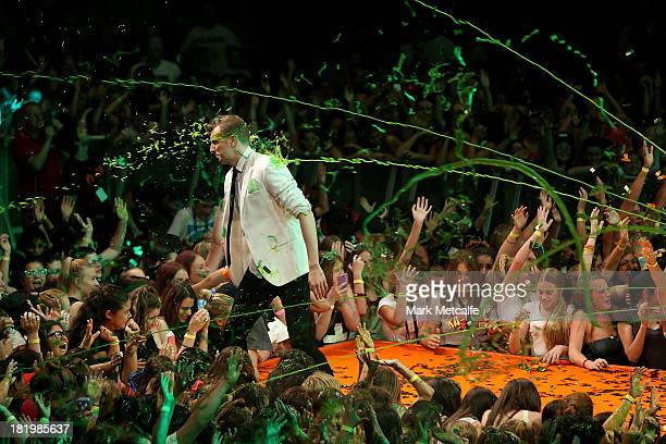 Host Luke Ryan gets slimed during the Nickelodeon Slimefest 2013 evening show at Sydney Olympic Park Sports Centre on September 27 2013 in Sydney...