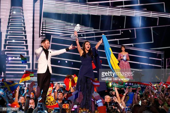 Host Mans Zelmerlow and Eurovision Song Contest winner 2016 Jamala representing Ukraine is seen on stage with her award at the Ericsson Globe on May...
