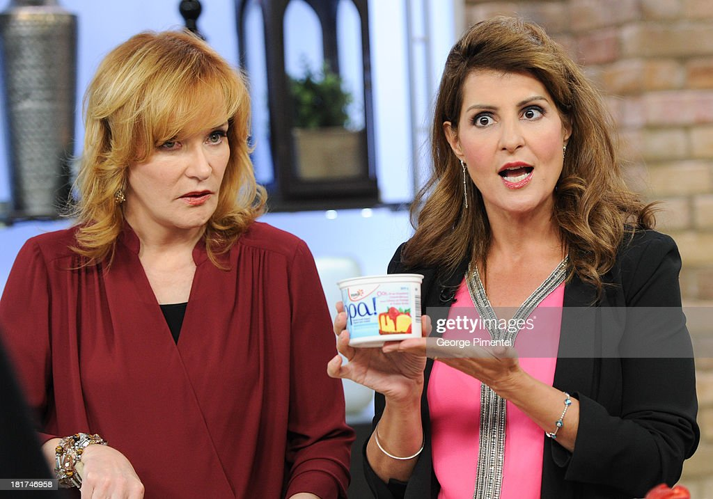 Host Marilyn Denis and Greek Canadian actress <a gi-track='captionPersonalityLinkClicked' href=/galleries/search?phrase=Nia+Vardalos&family=editorial&specificpeople=201549 ng-click='$event.stopPropagation()'>Nia Vardalos</a> appear live on the Marilyn Denis Show at Bell Media Headquarters on September 24, 2013 in Toronto, Canada.