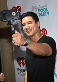 TV host Mario Lopez takes a selfie during The iHeartRadio Summer Pool Party at Caesars Palace on May 30 2015 in Las Vegas Nevada