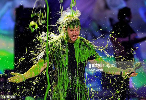 Host Mark Wahlberg gets slimed onstage during Nickelodeon's 27th Annual Kids' Choice Awards held at USC Galen Center on March 29 2014 in Los Angeles...