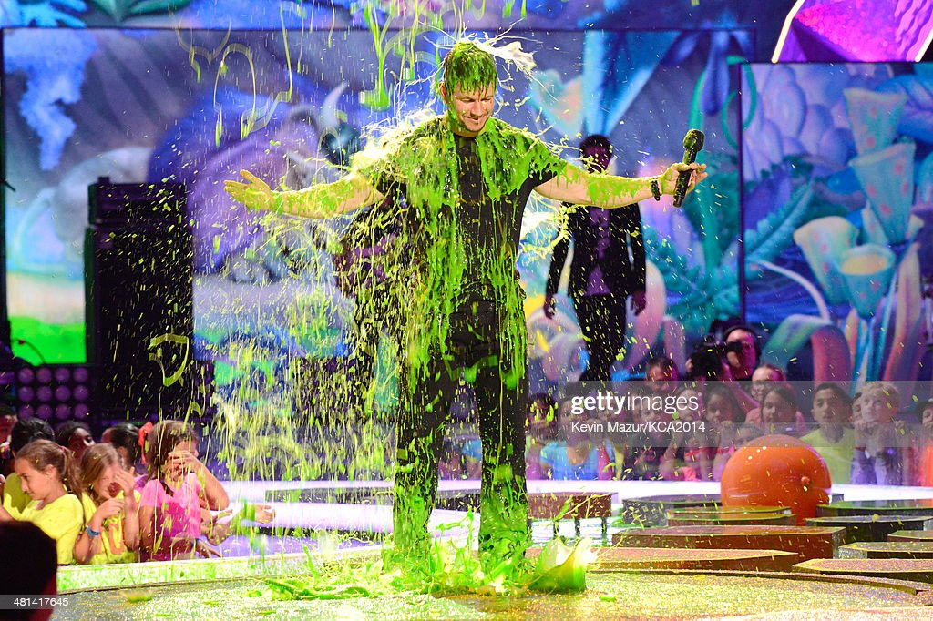 Host <a gi-track='captionPersonalityLinkClicked' href=/galleries/search?phrase=Mark+Wahlberg&family=editorial&specificpeople=202265 ng-click='$event.stopPropagation()'>Mark Wahlberg</a> gets slimed onstage during Nickelodeon's 27th Annual Kids' Choice Awards held at USC Galen Center on March 29, 2014 in Los Angeles, California.