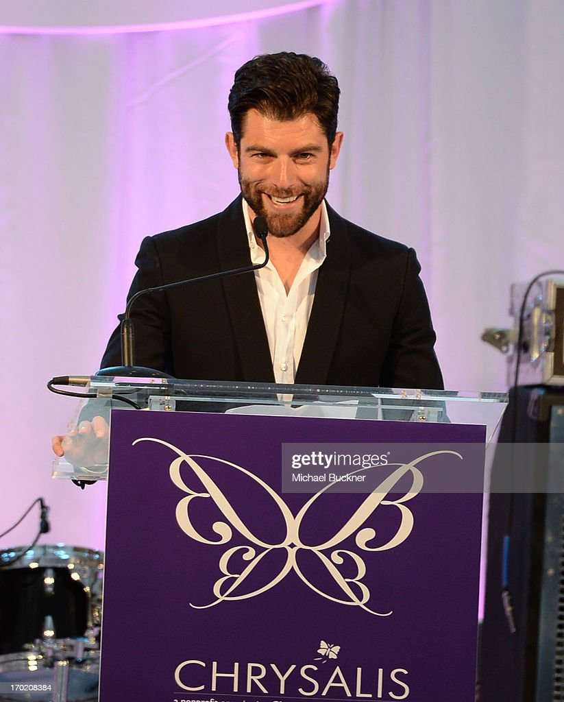 Host <a gi-track='captionPersonalityLinkClicked' href=/galleries/search?phrase=Max+Greenfield&family=editorial&specificpeople=599135 ng-click='$event.stopPropagation()'>Max Greenfield</a> speaks onstage during the 12th Annual Chrysalis Butterfly Ball on June 8, 2013 in Los Angeles, California.