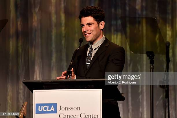 Host Max Greenfield speaks onstage during the 20th Anniversary Taste for a Cure fundraiser benefitting UCLA's Jonsson Comprehensive Cancer Center at...