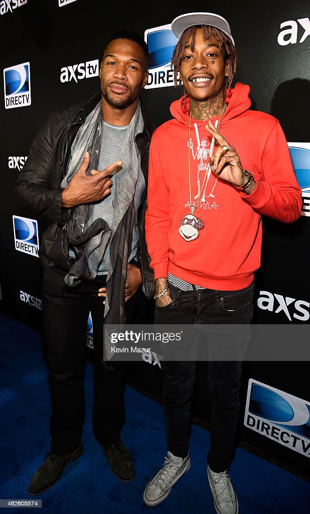 Host Michael Strahan and recording artist Wiz Khalifa attend DirecTV Super Saturday Night hosted by Mark Cuban's AXS TV and Pro Football Hall of...