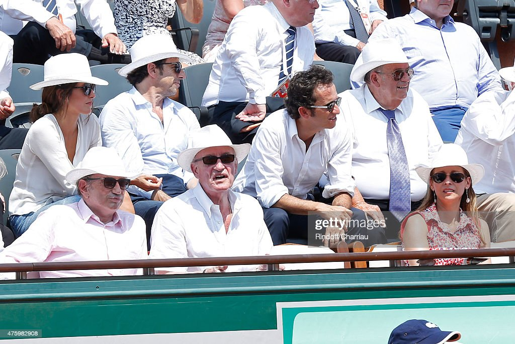 TV Host Michel Drucker, Pascal Desprez, Miss Manule Valls, Violonist Anne Gravoin, (2nd Row 3rd L-R) Patrick Bruel with Caroline Nielsen and CEO of Fnac Alexandre Bompard attend the 2015 Roland Garros French Tennis Open - Day Thirteen, on June 5, 2015 in Paris, France.