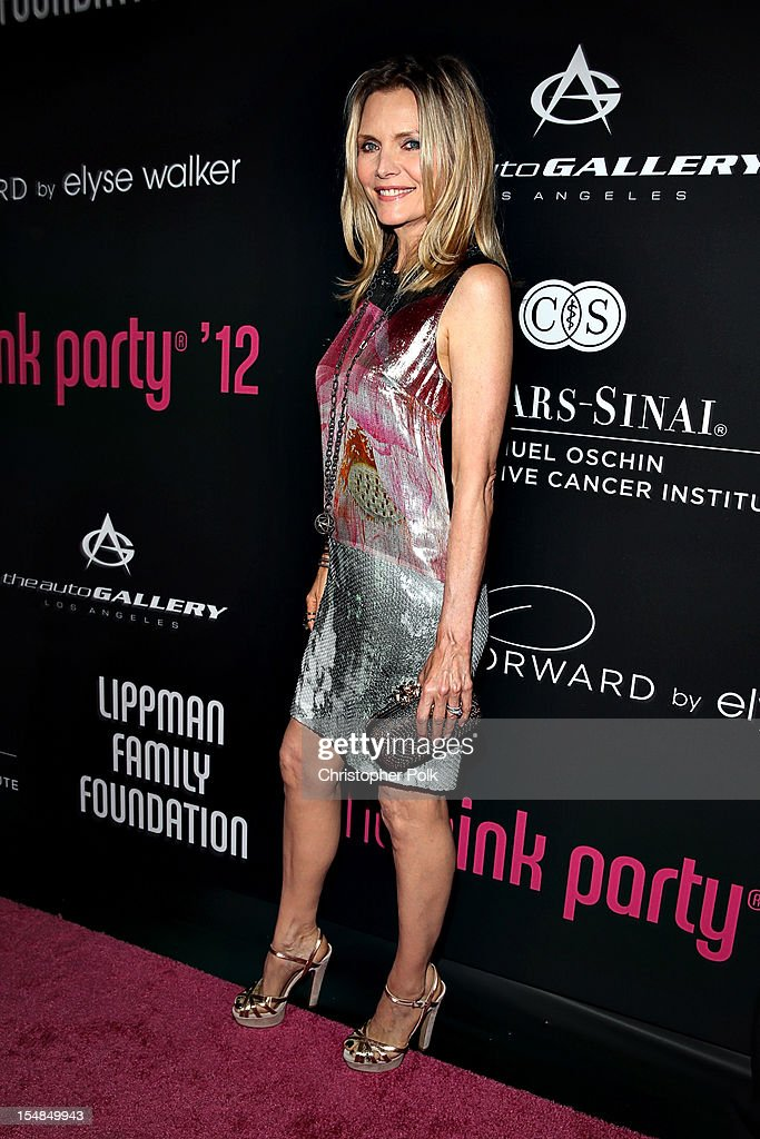 Host <a gi-track='captionPersonalityLinkClicked' href=/galleries/search?phrase=Michelle+Pfeiffer&family=editorial&specificpeople=212951 ng-click='$event.stopPropagation()'>Michelle Pfeiffer</a> arrives at Elyse Walker presents the 8th annual Pink Party hosted by <a gi-track='captionPersonalityLinkClicked' href=/galleries/search?phrase=Michelle+Pfeiffer&family=editorial&specificpeople=212951 ng-click='$event.stopPropagation()'>Michelle Pfeiffer</a> to benefit Cedars-Sinai Women's Cancer Program held at