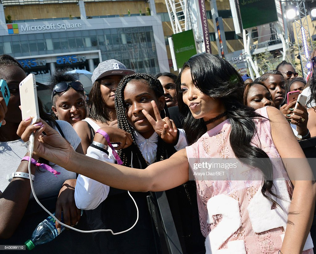 Host Mila J takes photos with fans at 106 & Park Sponsored by Coca-Cola during the 2016 BET Experience on June 25, 2016 in Los Angeles, California.