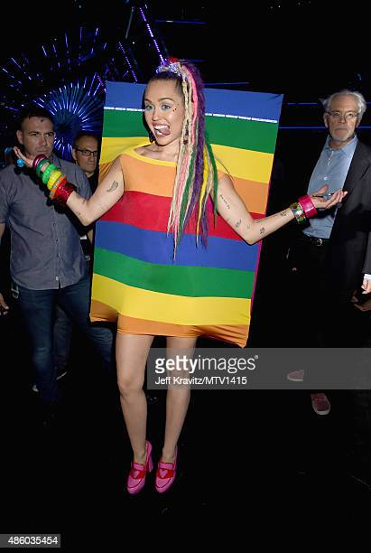 Host Miley Cyrus poses backstage during the 2015 MTV Video Music Awards at Microsoft Theater on August 30 2015 in Los Angeles California