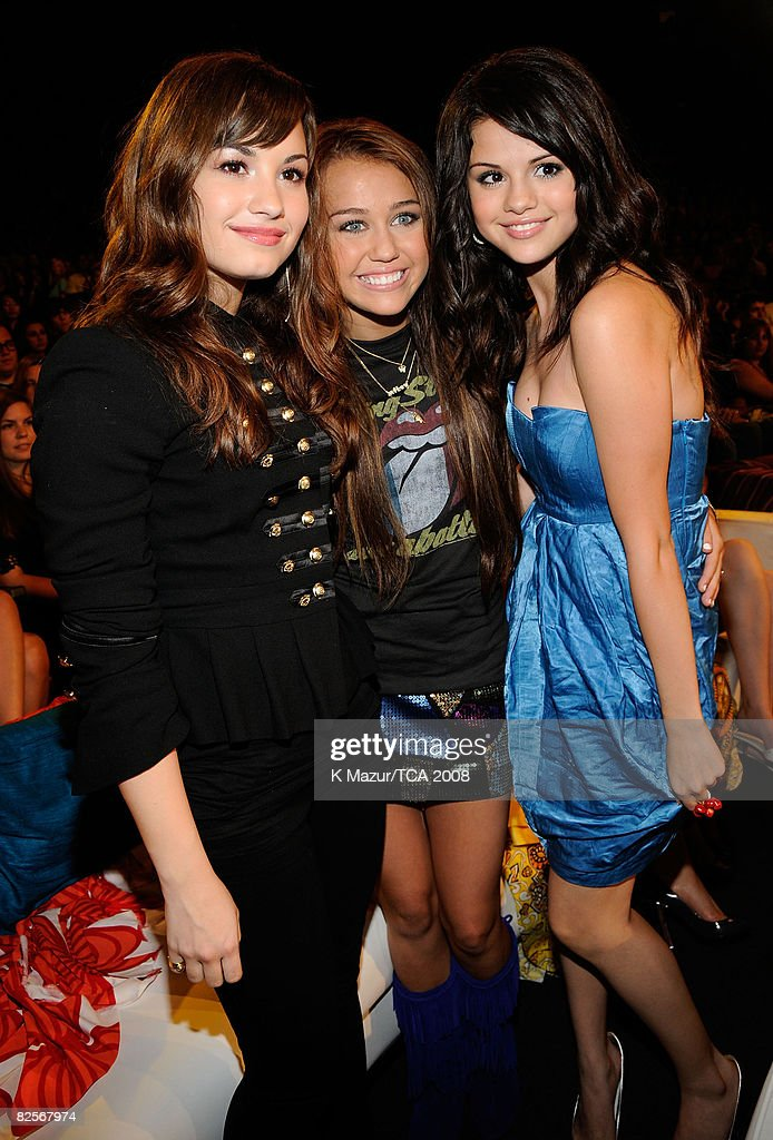 Host Miley Cyrus (center) with <a gi-track='captionPersonalityLinkClicked' href=/galleries/search?phrase=Demi+Lovato&family=editorial&specificpeople=4897002 ng-click='$event.stopPropagation()'>Demi Lovato</a> and <a gi-track='captionPersonalityLinkClicked' href=/galleries/search?phrase=Selena+Gomez&family=editorial&specificpeople=4295969 ng-click='$event.stopPropagation()'>Selena Gomez</a> during the 2008 Teen Choice Awards at Gibson Amphitheater on August 3, 2008 in Los Angeles, California.