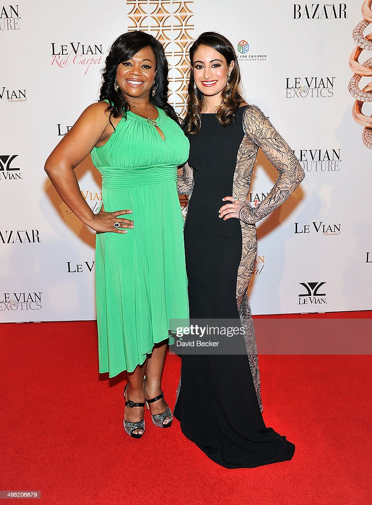 Host Monica Jackson (L) and Harper's Bazaar Merchandising Editor Michelle Fawbush arrive at the 2015 Le Vian Red Carpet Revue at the Mandalay Bay Convention Center on June 1, 2014 in Las Vegas, Nevada.