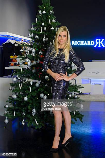 TV host Nadine Krueger poses during a photo session in front of a christmas tree at fashion designer Richard Kravetz's venue on December 01 2013 in...
