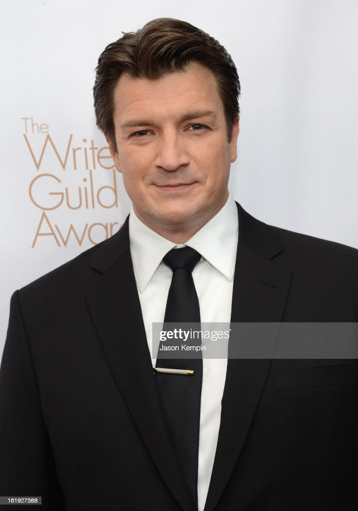Host <a gi-track='captionPersonalityLinkClicked' href=/galleries/search?phrase=Nathan+Fillion&family=editorial&specificpeople=834463 ng-click='$event.stopPropagation()'>Nathan Fillion</a> arrives at the 2013 WGAw Writers Guild Awards at JW Marriott Los Angeles at L.A. LIVE on February 17, 2013 in Los Angeles, California.