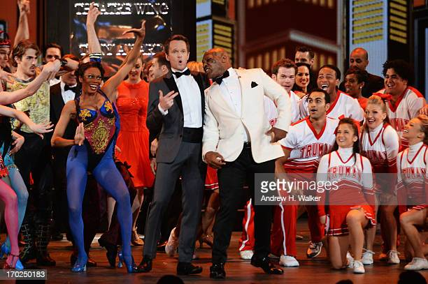 Host Neil Patrick Harris and Mike Tyson perform onstage at The 67th Annual Tony Awards at Radio City Music Hall on June 9 2013 in New York City