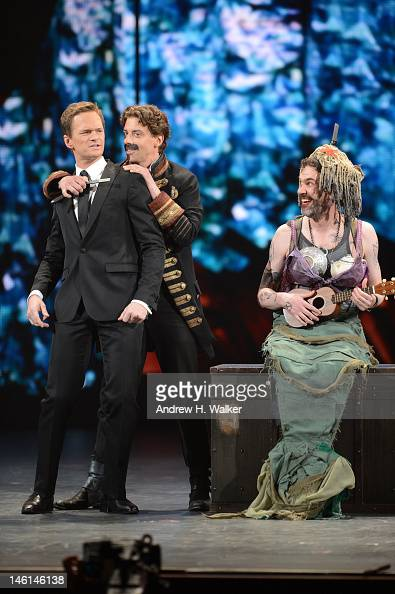 Host Neil Patrick Harris performs with Christian Borle and Kevin Del Aguila of Peter and the Starcatcher onstage at the 66th Annual Tony Awards at...