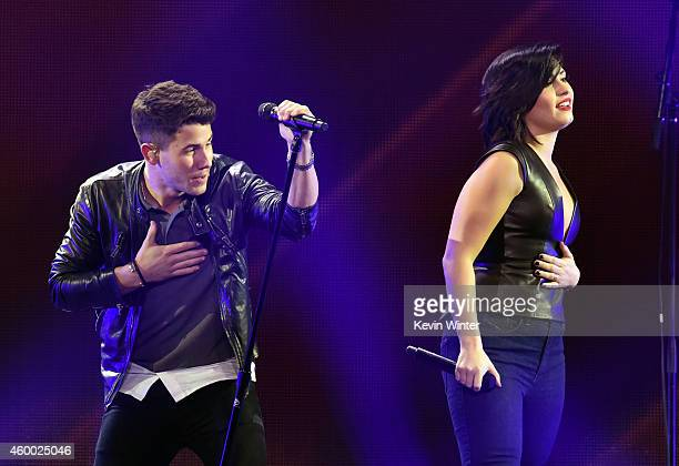 Host Nick Jonas and recording artist/actress Demi Lovato perform onstage during KIIS FM's Jingle Ball 2014 powered by LINE at Staples Center on...