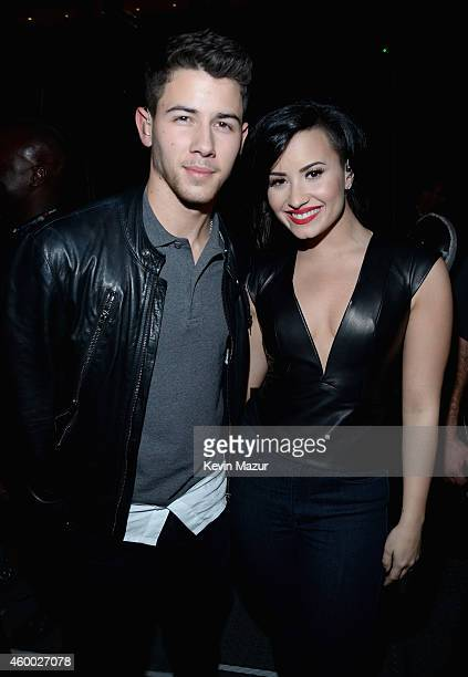 Host Nick Jonas and singer Demi Lovato attend KIIS FM's Jingle Ball 2014 powered by LINE at Staples Center on December 5 2014 in Los Angeles...