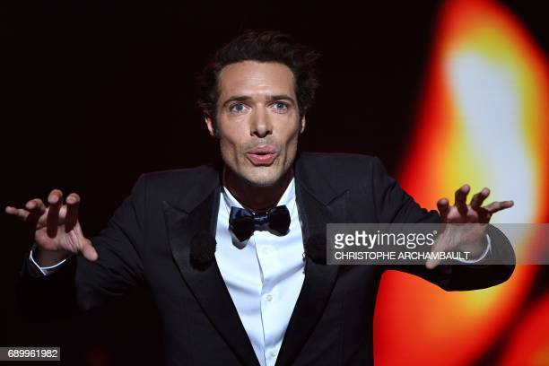 Host Nicolas Bedos gestures during the French theatre awards 'Molieres' ceremony at the Folies Bergeres Theatre in Paris on May 29 2017 / AFP PHOTO /...
