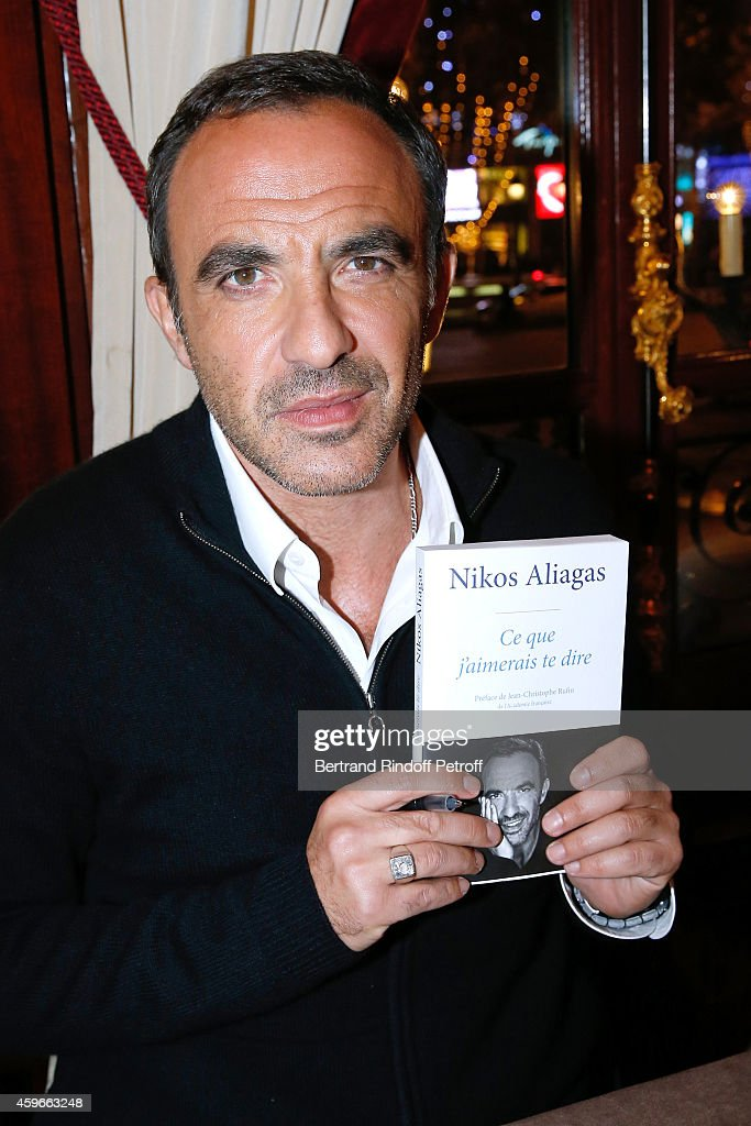 TV Host <a gi-track='captionPersonalityLinkClicked' href=/galleries/search?phrase=Nikos+Aliagas&family=editorial&specificpeople=573643 ng-click='$event.stopPropagation()'>Nikos Aliagas</a> attends the 37th Writers Cocktail, organized by Circle Maxim's Business Club in Fairs Fouquet's, on November 27, 2014 in Paris, France.