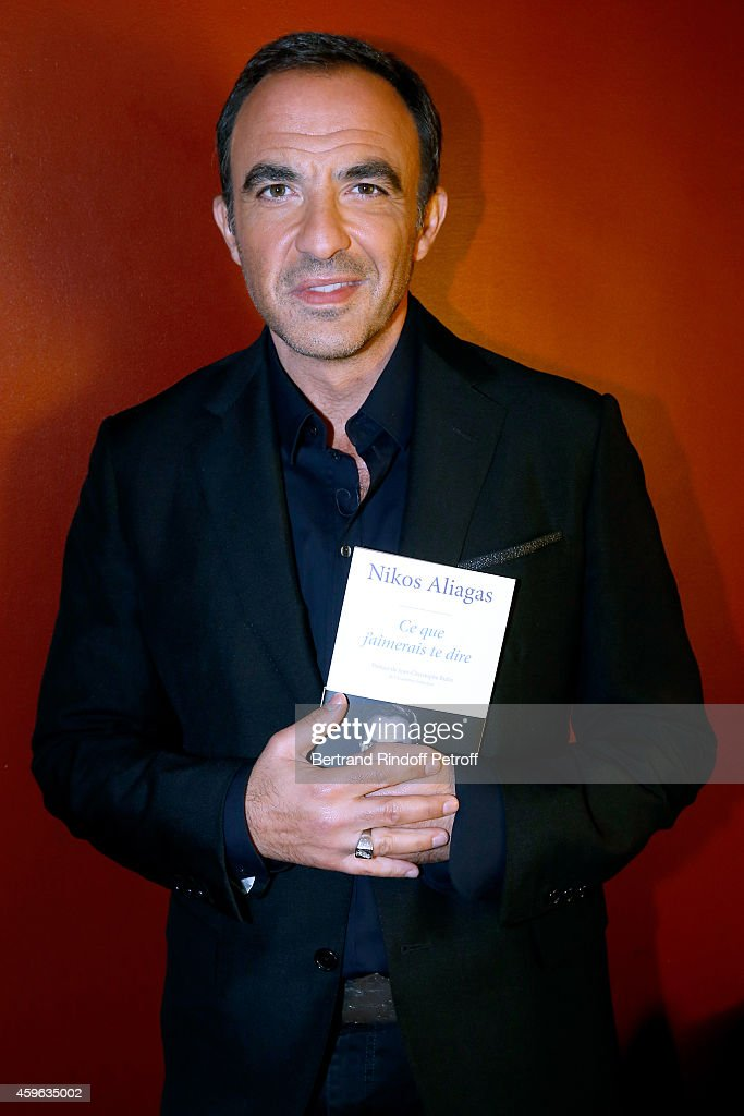 TV host <a gi-track='captionPersonalityLinkClicked' href=/galleries/search?phrase=Nikos+Aliagas&family=editorial&specificpeople=573643 ng-click='$event.stopPropagation()'>Nikos Aliagas</a> presents his book 'J'aimerais te dire' during the 'Vivement Dimanche' French TV Show at Pavillon Gabriel on November 26, 2014 in Paris, France.