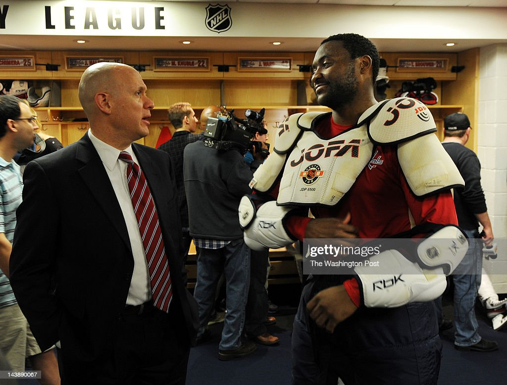 Host of Capitals Voice John Walton (L) talks with Washington Capitals #42 Joel Ward inside the Washington Capitals locker after a team practice on May 4, 2012. Members of the media came into the locker room for interviews after Captials team practice at the Kettler Captials Iceplex in Arlington, VA.