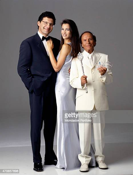 'TV host of the 1999 edition of Miss Italia Fabrizio Frizzi is portrayed in a tuxedo together with the winner of previous year beauty contest Gloria...