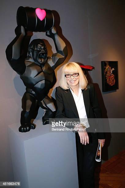 Host of the event actress Mireille Darc attends 'Le Coeur Des Createurs' Auction at Christie's in favor of La Chaine de l'Espoir on July 3 2014 in...