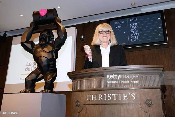 Host of the event actress Mireille Darc gives the starting of 'Le Coeur Des Createurs' Auction at Christie's in favor of La Chaine de l'Espoir on...