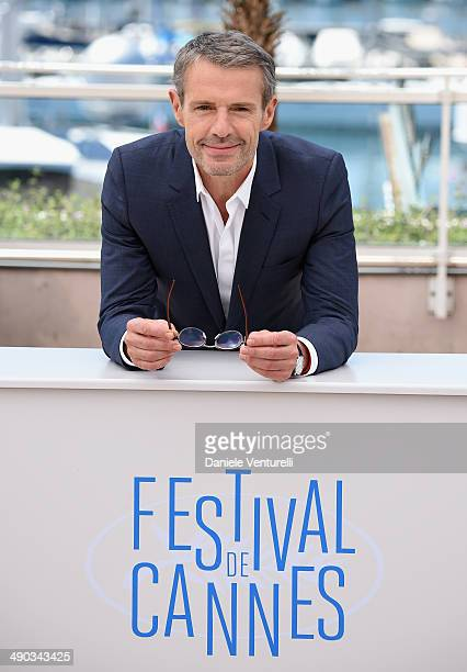 Host of the opening and closing ceremony Lambert Wilson attends a photocall during the 67th Annual Cannes Film Festival on May 14 2014 in Cannes...