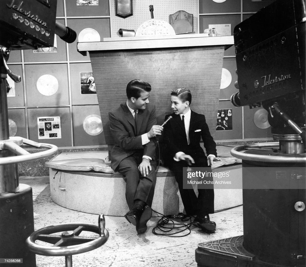 Host of the television show 'American Bandstand' Dick Clark interviews child actor Johnny Crawford in circa 1957