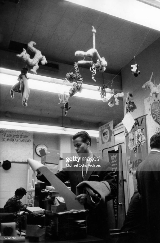 Host of the television show 'American Bandstand' Dick Clark shows off the gimmick gifts in his office for a reporter on May 13 1958 in Philadelphia...