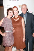 TV host Paige Davis Noreen Fraser and Woody Fraser pose at the Stella Dot VIP Trunk Show Benefiting The Noreen Fraser Foundation at Regent Beverly...