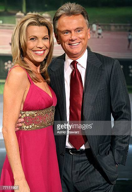 Host Pat Sajak and cohost Vanna White pose for photos during a taping of 'Wheel Of Fortune Celebrity Week' celebrating the television game show's...