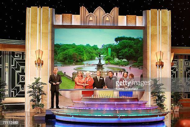 Host Pat Sajak greets Tara Carroll Paula Deen James Thompson actor Steve Schirripa Joy Bryant and actress Sherri Shepherd during a taping of 'Wheel...