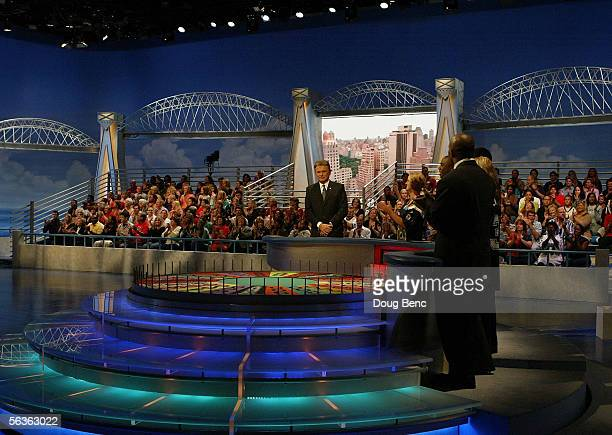 Host Pat Sajak performs with NFL players during taping of the NFL Players Week 10th Anniversary on Wheel Of Fortune on December 6 2005 in Fort...
