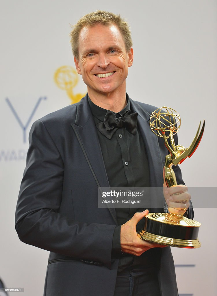 TV host <a gi-track='captionPersonalityLinkClicked' href=/galleries/search?phrase=Phil+Keoghan&family=editorial&specificpeople=220619 ng-click='$event.stopPropagation()'>Phil Keoghan</a> poses in the 64th Annual Emmy Awards press room at Nokia Theatre L.A. Live on September 23, 2012 in Los Angeles, California.