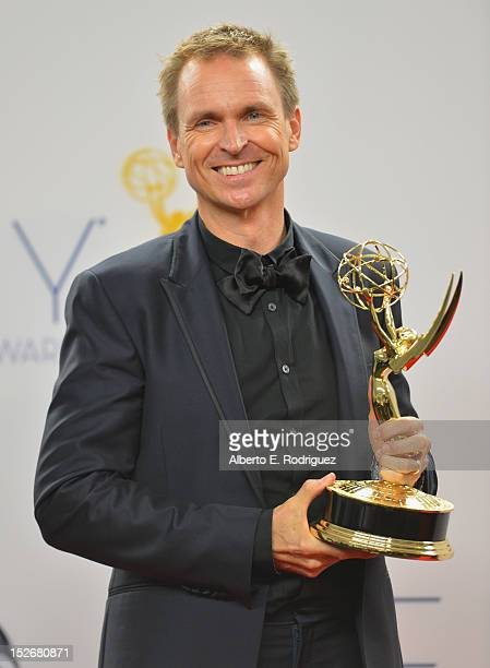 TV host Phil Keoghan poses in the 64th Annual Emmy Awards press room at Nokia Theatre LA Live on September 23 2012 in Los Angeles California